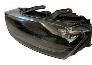 Audi Q3 2013 left hand headlight