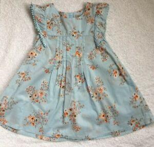 Next Baby Girl's light blue floral print  dress. 9 - 12 months x con