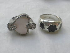 2 SILVER COLOURED COCKTAIL RINGS - ONE HEART AND ONE WITH BLACK STONES