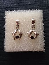 Solid silver earrings, two dolphins with red ruby