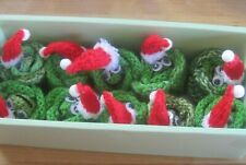 A HAND KNITTED SANTA BRUSSEL SPROUT XMAS TABLE DECORATION. FOR A CHOC.