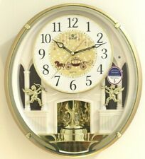 Power Melodies in Motion rotational pendulum wall clock with Led light (Pw6241Am