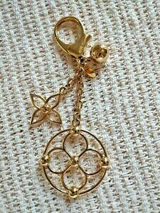 Louis Vuitton Bloomy bag charm. Goldtone.