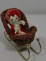 Small Vintage Hand Made Oriental Baby Doll  In Wicker& Brass Sleigh
