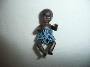 alte Puppe E. S. 5,5 cm Baby Bastrock dunkelhäutig Puppenstubenpuppe farbig