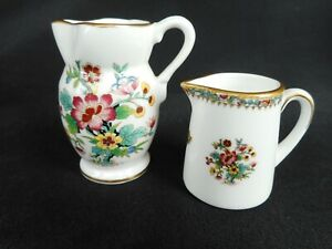 TWO MINIATURE COALPORT WATER JUGS ~ DECORATED IN THE ' MING ROSE ' PATTERN.