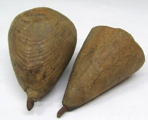 Two Handcarved Primitive Wooden Spinning Tops