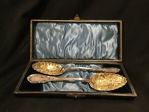 Pair of beautiful antique Highly Ornate Cased Serving spoons c4