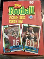 1990 Topps football wax box. Possible Sanders, Aikman, Montana, Rice,Seau. (1)