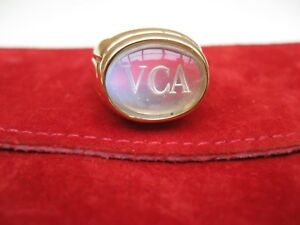 Van Cleef and Arpels 18 k y/g heavy ring with moon stone and engraved logo