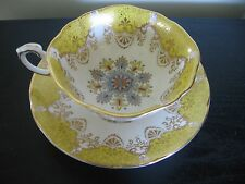 PARAGON YELLOW COLORFUL SNOWFLAKE TEACUP AND SAUCER