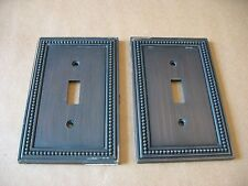 A pair of 2003 LHMC heavy duty decorative metal light switch cover plates