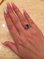 Wonderful 14k yellow gold natural emerald cut sapphire and baguette diamond ring