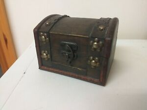 NICE ITEM...WOODEN BOX...STYLED AS A TREASURE CHEST..HINGED LID..WOOD...BOX