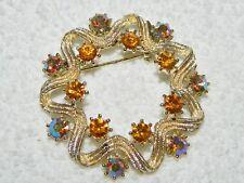 Amber & AB Rhinestone Textured Goldtone Round & Star Brooch Pin