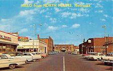 Nebraska postcard Hello from North Platte, street scene Johnny's Bus Depot Cafe