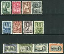 NIGERIA-1936 An average mounted mint set to £1, toned gum Sg 34-45