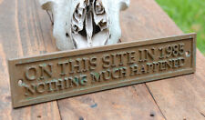 """ON THIS SITE IN 1985 NOTHING MUCH HAPPENED"" Funny Bronze Resin Wall Shed plaque"