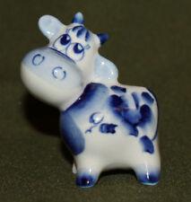 Vintage hand made small porcelain cow figurine