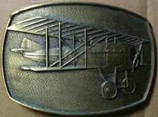 Brass Belt Buckle With Raised Image of WW I Bi-Plane With British Insignia