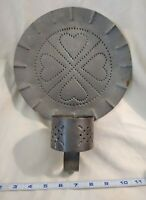 Punched tin wall-mount candle holder