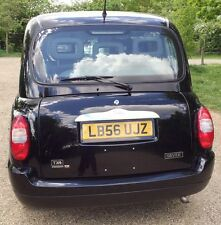 Taxi Tx4 Rear Chrome Plinth Cover with Chrome Wolf Embellisher