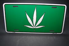 MARIJUANA LEAF NOVELTY METAL CAR LICENSE PLATE ONE WORLD ONE LOVE LEGALIZE IT.