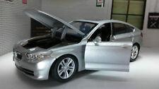 Voitures, camions et fourgons miniatures argentés BMW
