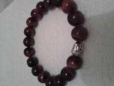 Bracelet en perles d'oeil de fer de diamètre 12 mm, environ 6 cm de diamètre