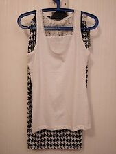2 pc skirt & top. 8/10. B/W hounds tooth skirt, plain white top
