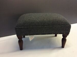 Footstool upholstered in a 100% wool fabric
