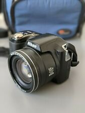 Nikon COOLPIX L100 10.0MP Black Digital Camera with Navy Carrying Case