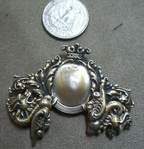 Marked Sterling ladies belt buckle,,dragons and crown, very detailed.