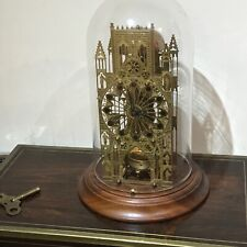 Domed glass Cathedral passing strike clock