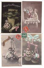 Ensemble 4 cartes postales Bébé et corbeille. Début XXe