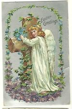 Beautiful Easter Angel hugs a large cross with flowers