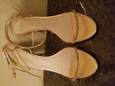 Chrtian Michaels high heel gold sandals