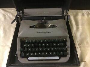Vintage typewriter by Remington in carrying case