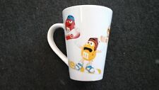 M & M's Mars Candy Coffee Cup / Mug with  M & M Characters riding snowboards