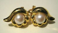 Gorgeous clip-on gold tone metal earrings with faux pearl setting