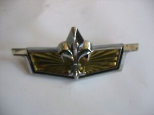 New NOS GM Chevy Caprice 1986 Header Panel Emblem Ornament 14085026