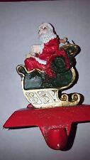 Santa fireplace mantle Christmas cast iron / resin holiday stocking holder vtg