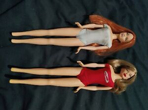 2 Integrity Colllectors  Dolls, with genuine swimsuits.