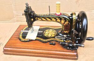Beautiful Rarest Stitchwell fiddle base hand crank sewing Machine