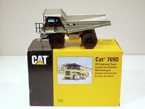 "Caterpillar 769D Dump Truck - ""PALE GOLD"" - 1/50 - NZG #477 - N.MIB"