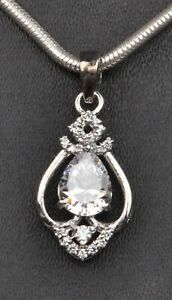 14KT Solid White Gold / 2.80Ct Pear Cut Solitaire With Accents Women's Pendant