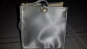 Estee Lauder silver evening  bag with 3 lipsticks value $60