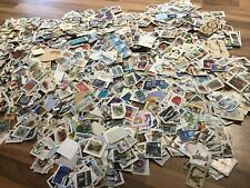 GB British Commemorative stamps on clipped down paper Kiloware. 500+ stamps