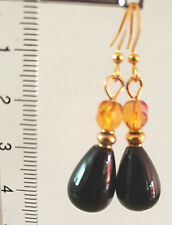 Gold tone earrings with  black agate beads and crystal beads