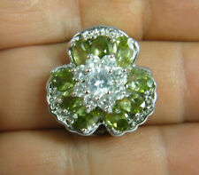 RING:   SIZE 7,   SELECT FLOWER PERDOT OVAL WHITE SAPPHIRE  925 STERLING SILVER